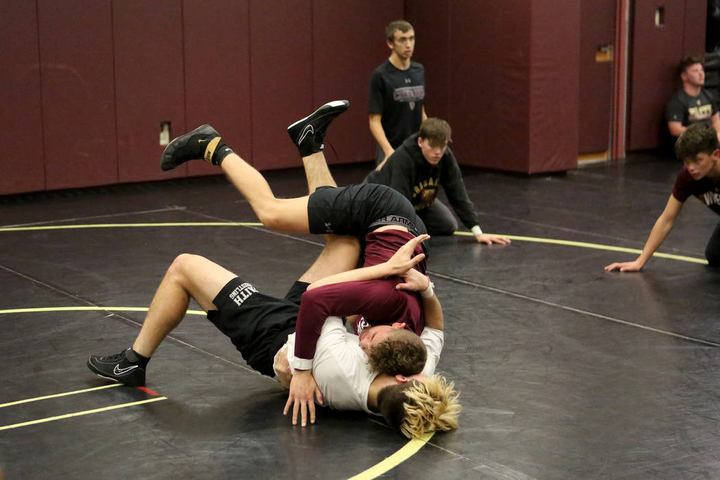 Connor Bourne, bottom, throws drilling partner Carson Cook during wrestling practice at Faith Lutheran High School on Tuesday, Dec. 12, 2017. Michael Quine/Las Vegas Review-Journal @Vegas88s
