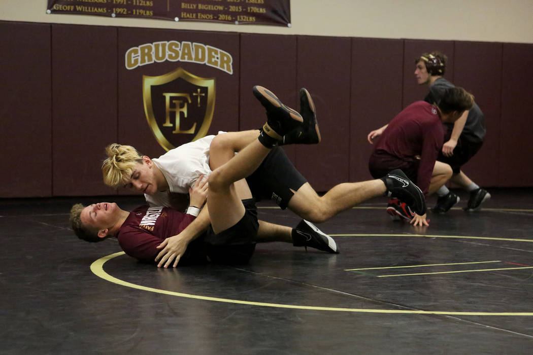 Connor Bourne, top, takes down drilling partner Carson Cook during wrestling practice at Faith Lutheran High School on Tuesday, Dec. 12, 2017. Michael Quine/Las Vegas Review-Journal @Vegas88s