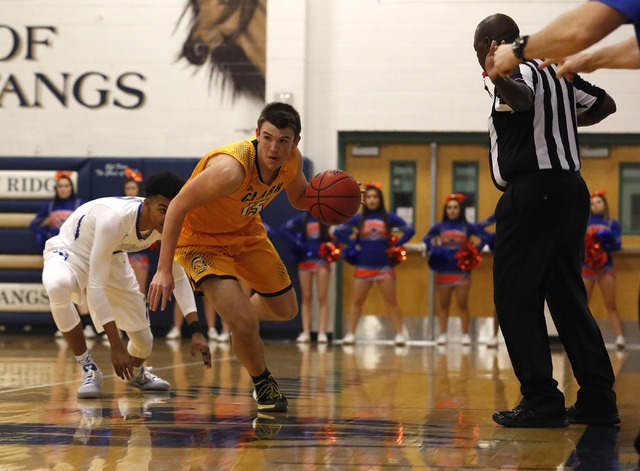 Clark's James Bridges (15) drive the ball pass Bishop Gorman's Jamal Bey (2) during the first half of a Class 4A Sunset Region championship boys basketball game on Saturday, Feb. 18, 2017, in Nort ...
