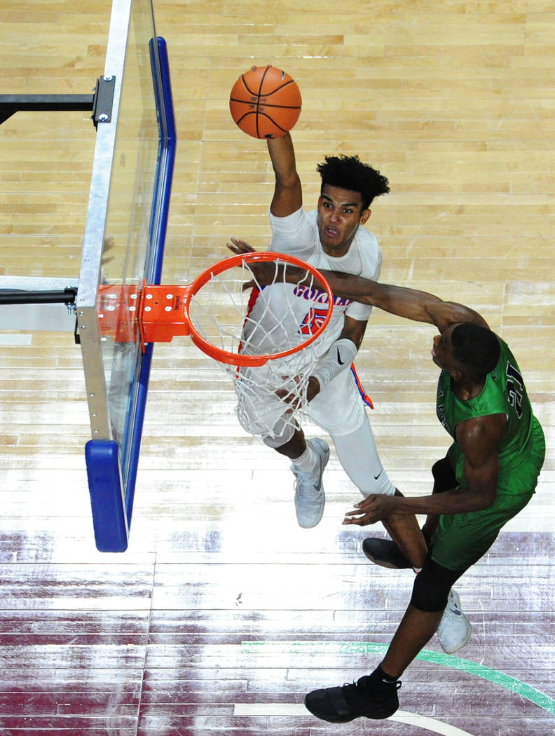 Bishop Gorman guard Jamal Bey dunks on Overland, Colo. forward Laolu Oke during their prep basketball game at Orleans Arena in Las Vegas Wednesday, Dec. 20, 2017. Josh Holmberg/Las Vegas Review-Jo ...