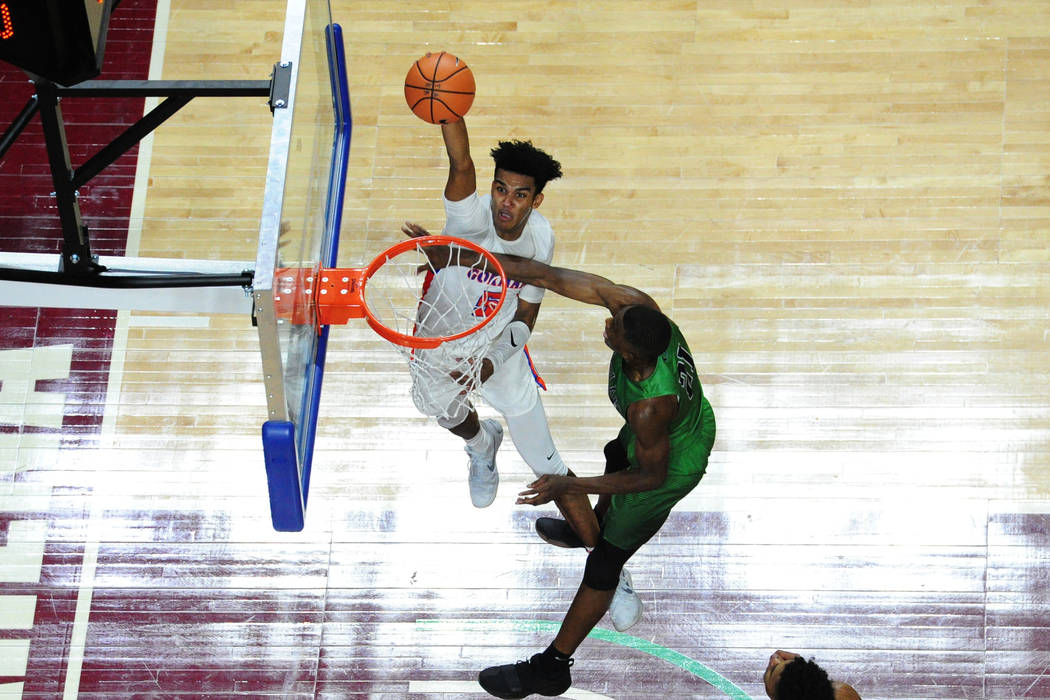 Bishop Gorman guard Jamal Bey attemps to dunk ove Overland, Colorado, forward Laolu Oke during their prep basketball game at Orleans Arena in Las Vegas Wednesday, Dec. 20, 2017. (Josh Holmberg/Las ...