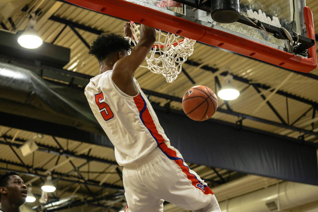 Bishop Gorman's Jamal Bey (5) scores a slam dunk against the Clark Chargers during the second half of the platinum division championship basketball game of the Tarkanian Classic at Bishop Gorman H ...