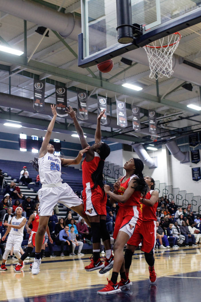 Centennial's Taylor Bigby (20) shoots the ball against Etiwanda's Kimora Sykes (4) during the first quarter of the Las Vegas Holiday Classic championship basketball game at Centennial High School  ...