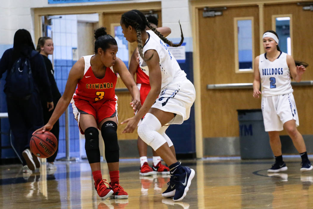 Etiwanda's Evanne Turner (3) is guarded by Centennial's Daejah Phillips (15) during the first quarter of the Las Vegas Holiday Classic championship basketball game at Centennial High School in Las ...