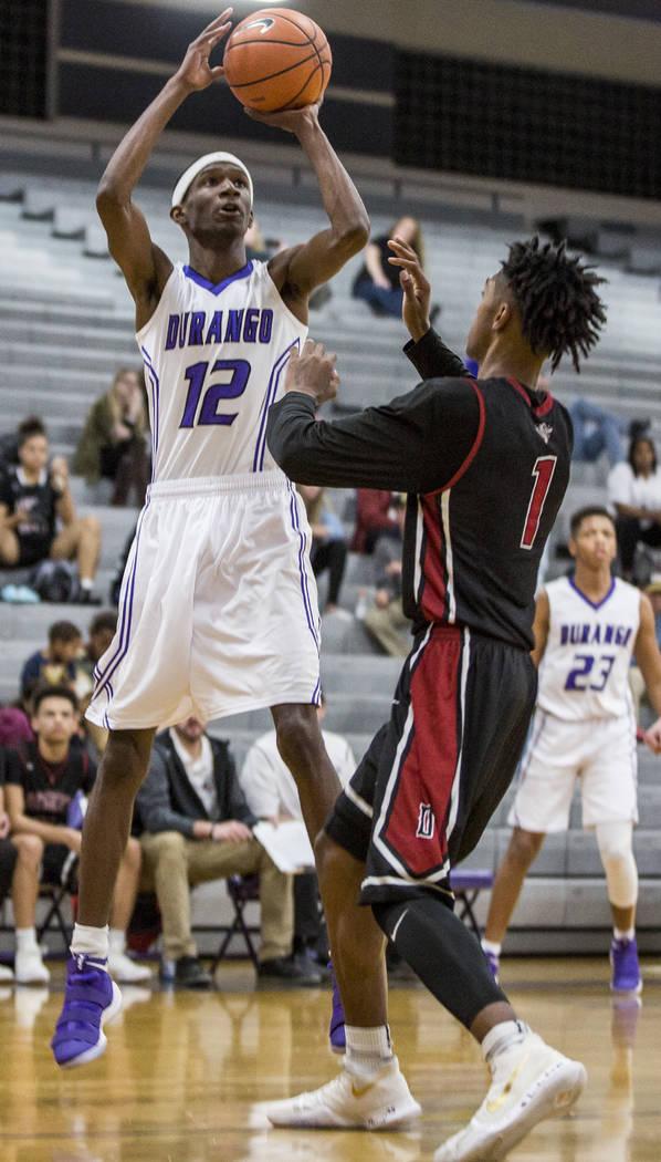 Durango's Leandre McIntyre (12) shoots while Desert Oasis' Felix Reeves (1) attempts to block him at Durango High School on Thursday, Jan. 18, 2018. Desert Oasis won 98-80.  Patrick Connolly Las V ...