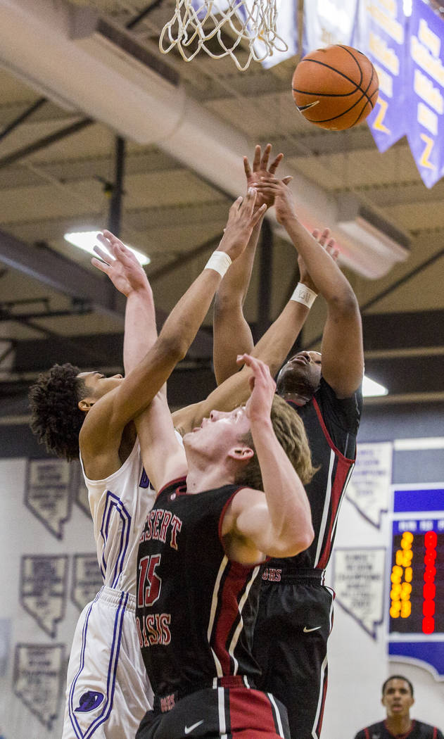 Durango's Vernell Watts (22) left, reaches for the ball as Desert Oasis players Jacob Heese (15) center, and Manny Mitchell (5) right, do the same at Durango High School on Thursday, Jan. 18, 2018 ...
