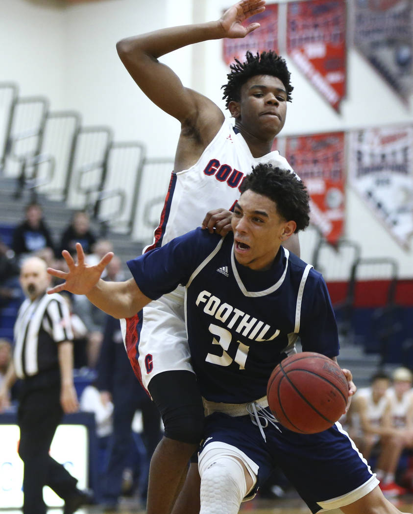 Foothill's Marvin Coleman (31) drives against Coronado's Jaden Hardy (1) during a basketball game at Coronado High School in Henderson on Friday, Jan. 19, 2018. Chase Stevens Las Vegas Review-Jour ...