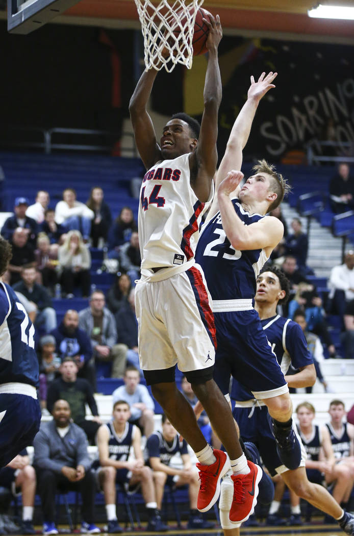 Coronado's Taieem Comeaux (44) goes to the basket past Foothill's Mike Shaw (23) during a basketball game at Coronado High School in Henderson on Friday, Jan. 19, 2018. Chase Stevens Las Vegas Rev ...