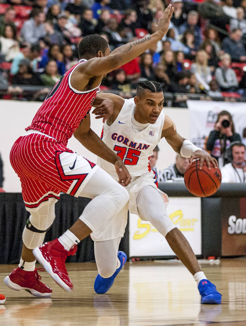 Bishop Gorman forward Jamal Bey (35) dribbles around Findlay Prep's Reggie Chaney (20) during the Big City Showdown at South Point in Las Vegas on Saturday, Jan. 20, 2018. Findlay Prep won 75-68.  ...