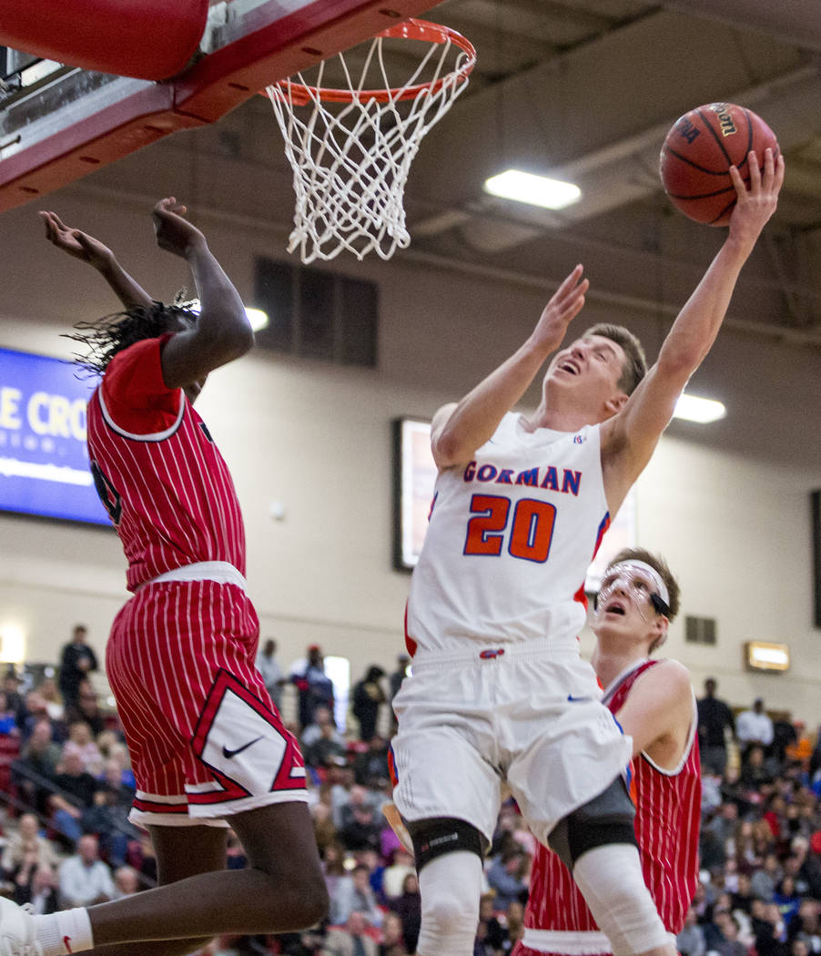 Bishop Gorman's Noah Taitz (20) shoots while Findlay Prep's Bol Bol (10) looks to block him during the Big City Showdown at South Point in Las Vegas on Saturday, Jan. 20, 2018. Findlay Prep won 75 ...