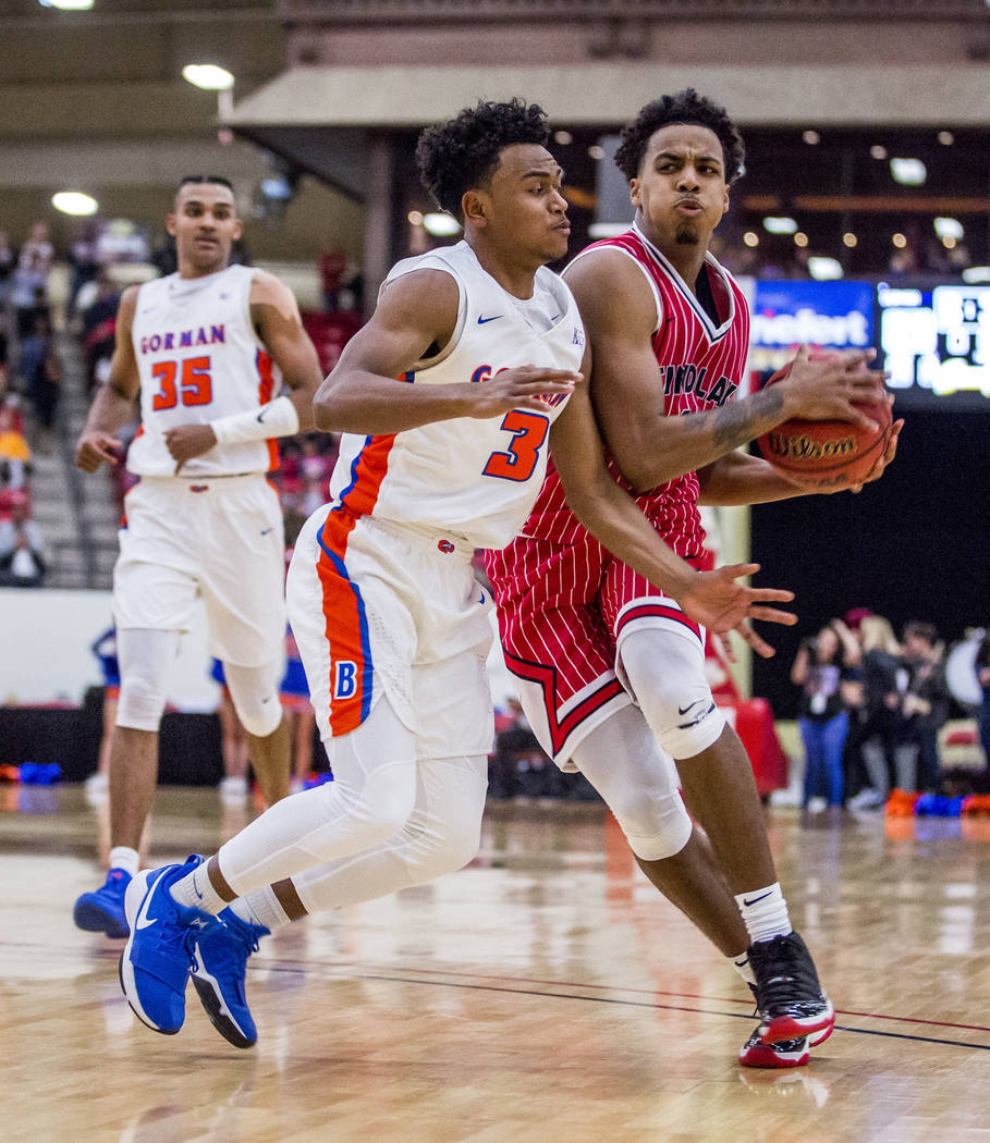 Findlay Prep's Kyler Edwards (11) tries to get around the defense of Bishop Gorman's D.J. Howe (3) during the Big City Showdown at South Point in Las Vegas on Saturday, Jan. 20, 2018. Findlay Prep ...