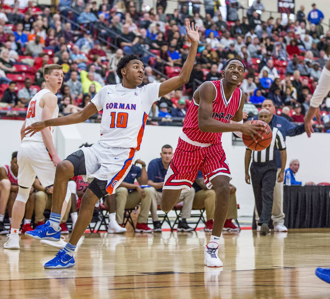 Findlay Prep's TJ Moss (1) looks to shoot as Bishop Gorman's Zaon Collins (10) looks to block him during the Big City Showdown at South Point in Las Vegas on Saturday, Jan. 20, 2018. Findlay Prep  ...