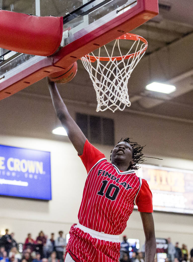Findlay Prep's Bol Bol (10) makes the team's final point during the Big City Showdown at South Point in Las Vegas on Saturday, Jan. 20, 2018. Findlay Prep won 75-68.  Patrick Connolly Las Vegas Re ...