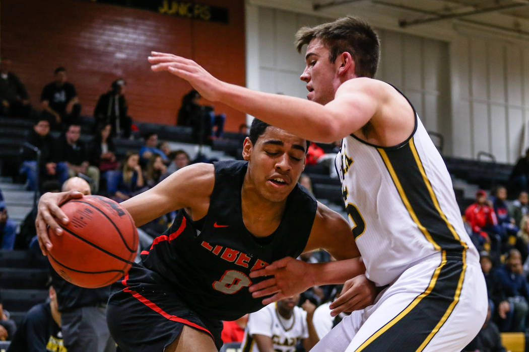 Liberty's Julian Strawther (0) is guarded by Clark Chargers' James Bridges (15) during the first quarter of a basketball game at Ed W. Clark High School in Las Vegas, Friday, Dec. 15, 2017. Clark  ...