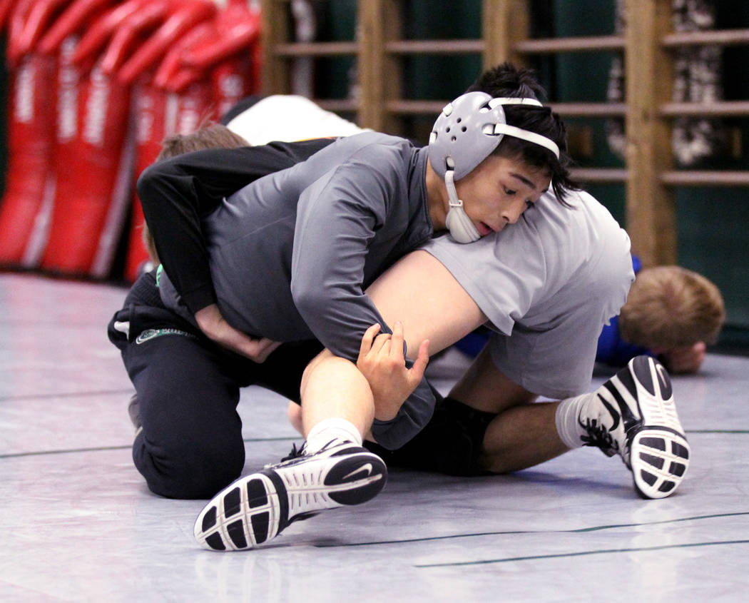 Green Valley High School junior wrestler Steele Dias, top, works on a move with his training partner, 120-pound sophomore William Zernich, during practice at the school in Henderson Monday, Jan. 2 ...