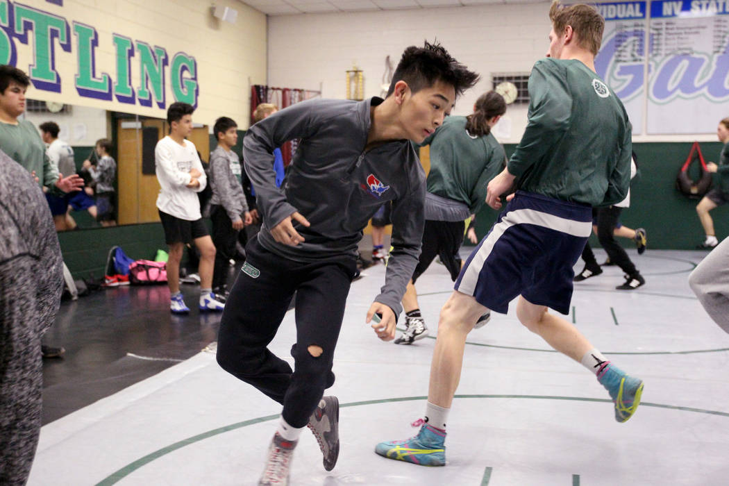 Green Valley High School junior wrestler Steele Dias, third from left, runs with his teammates during practice at the school in Henderson Monday, Jan. 24, 2018. Dias is one of the best 113-pounder ...