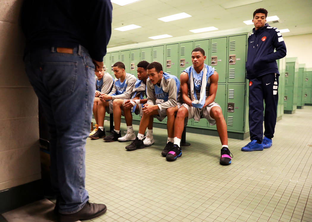 Canyon Springs' Kevin Legardy (4), as well as the rest of the team, sit in for a pep talk during a basketball game at Arbor View High School in Las Vegas, Monday, Jan. 22, 2018. Legardy is a high- ...