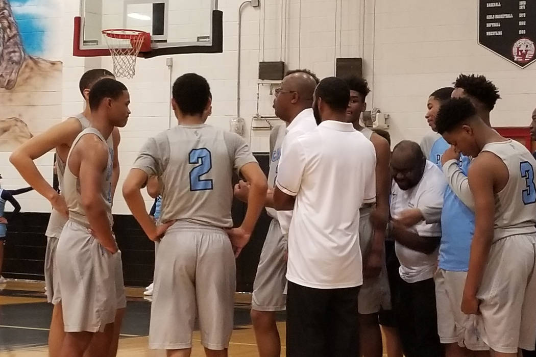 Canyon Springs coach Freddie Banks talks to his team during a timeout on Wednesday, Jan. 25 at Las Vegas High. The Pioneers won 91-77. (Damon Seiters/Las Vegas Review-Journal)