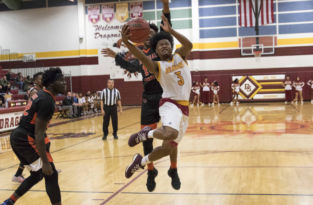 Del Sol point guard Antonio Simpson (3) goes up for a shot against Chaparral's Cairyn Bray during a varsity basketball game at Del Sol High School in Las Vegas, Friday, Jan. 26, 2018. Richard Bria ...