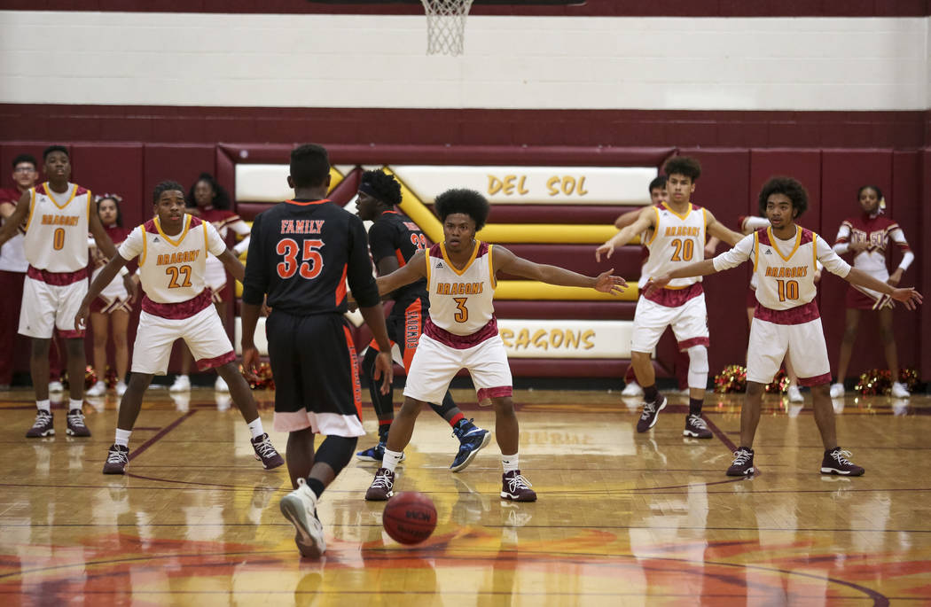 Del Sol defenders protect the court as Chaparral's Meshach Hawkins (35) drives the ball down court during a varsity basketball game at Del Sol High School in Las Vegas, Friday, Jan. 26, 2018. Rich ...