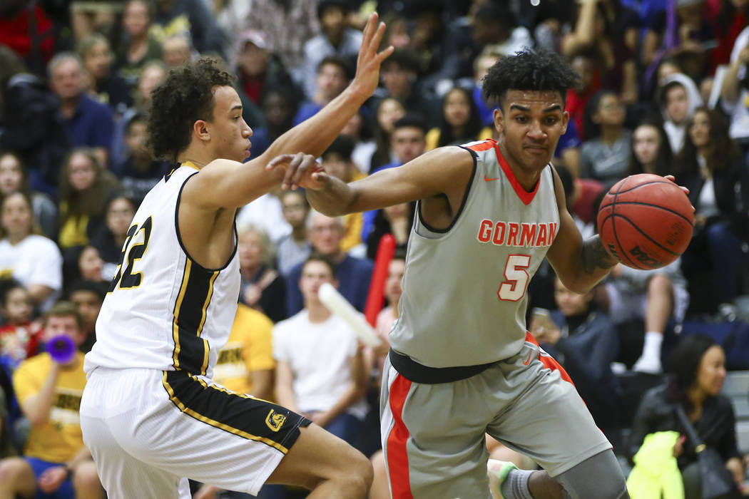 Bishop Gorman's Jamal Bey (5) drives against Clark's Ian Alexander (32) during a basketball game at Clark High School in Las Vegas on Tuesday, Jan. 30, 2018. Chase Stevens Las Vegas Review-Journal ...