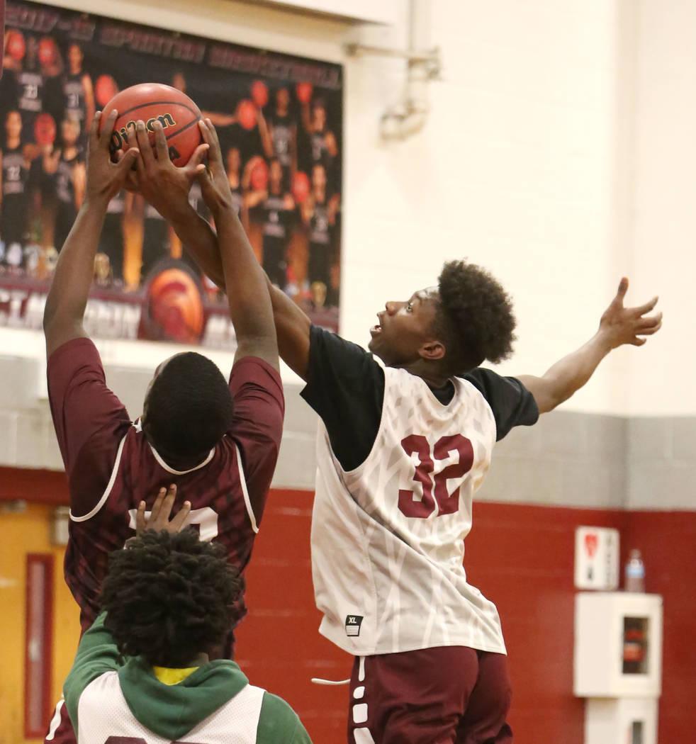 Cimarron-Memorial's Brian Washington (32) jumps for a rebound during teams practice at their school on Wednesday, Jan. 24, 2018, in Las Vegas. Bizuayehu Tesfaye Las Vegas Review-Journal @bizutesfaye