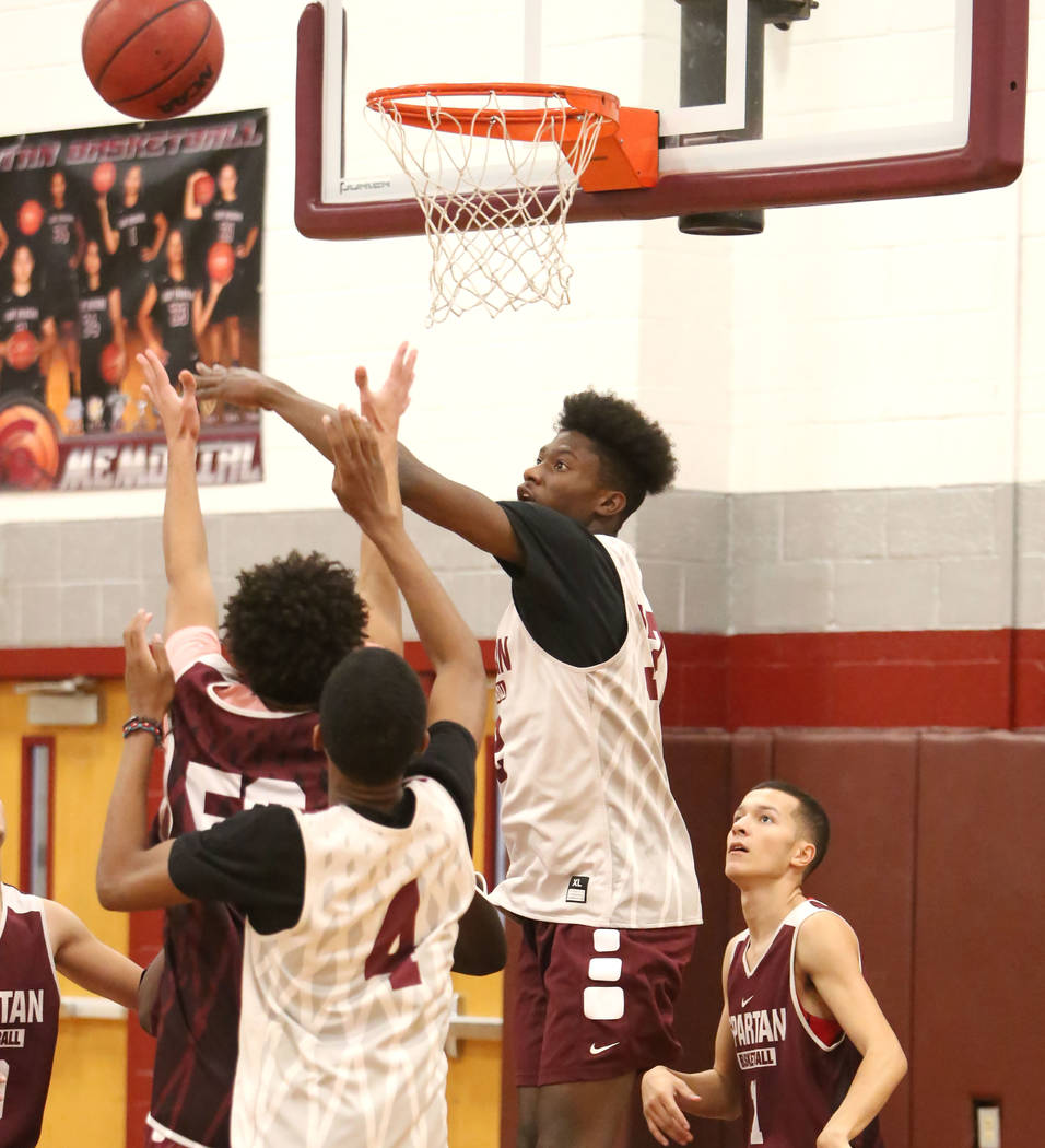 Cimarron-Memorial's Brian Washington, right, jumps for a rebound during teams practice at their school on Wednesday, Jan. 24, 2018, in Las Vegas. Bizuayehu Tesfaye Las Vegas Review-Journal @bizute ...