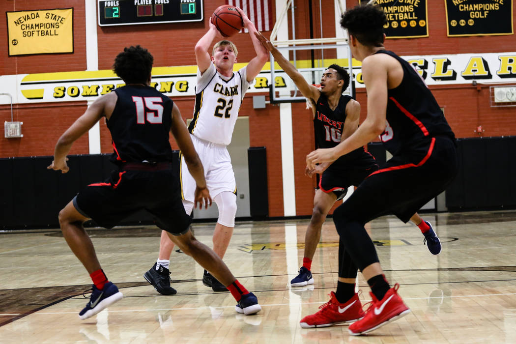 Clark Chargers' Trey Woodbury (22) prepares to pass the ball during the second quarter of a basketball game against Liberty at Ed W. Clark High School in Las Vegas, Friday, Dec. 15, 2017. Clark Ch ...