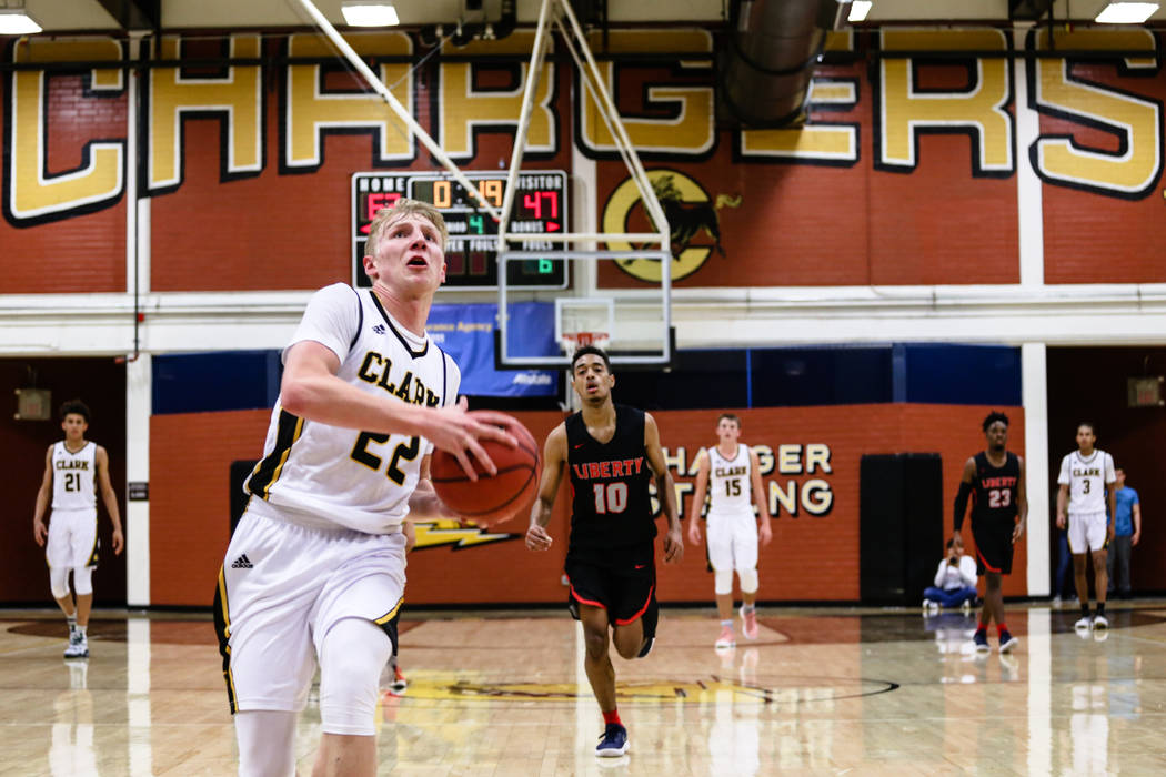 Clark Chargers' Trey Woodbury (22) runs before scoring a slam dunk against Liberty during the fourth quarter of a basketball game at Ed W. Clark High School in Las Vegas, Friday, Dec. 15, 2017. Cl ...