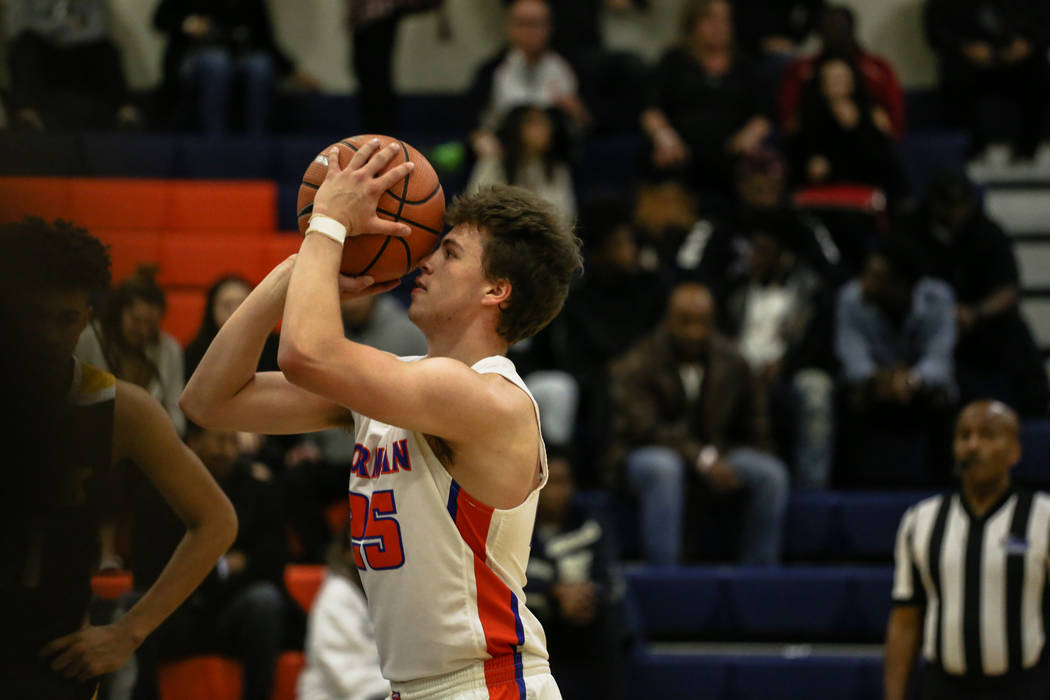 Bishop Gorman's Chance Michels (25) shoots a free-throw during the second half of the platinum division championship basketball game of the Tarkanian Classic at Bishop Gorman High School in Las Ve ...