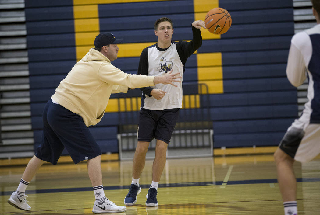 Carson Balistere makes a pass during a basketball team practice at Boulder City High School in Boulder City, Tuesday, Jan. 2, 2018. Erik Verduzco/Las Vegas Review-Journal