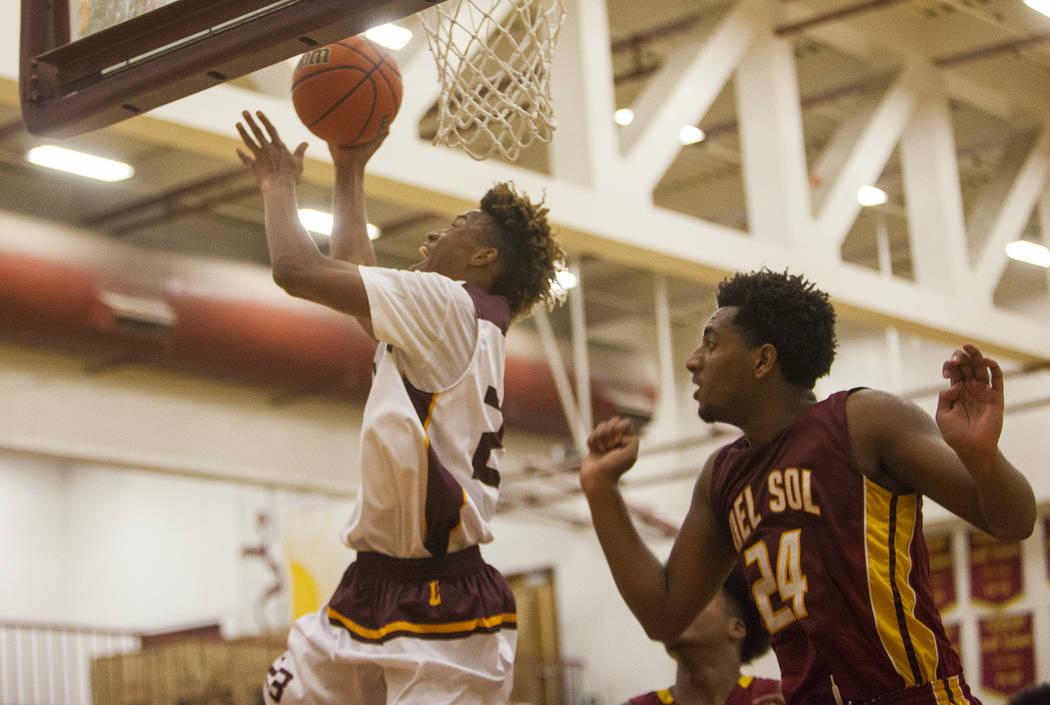 Eldorado's Kemo Bell (23) throws a basket against Del Sol's Nati Asfaw (24) in Las Vegas, Wednesday, Jan. 3, 2018 at Eldorado high school. Rachel Aston Las Vegas Review-Journal @rookie__rae