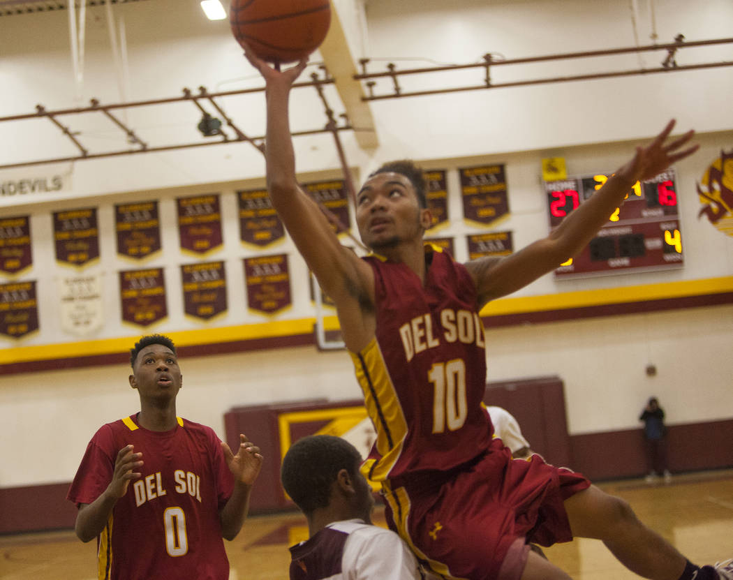 Del Sol's Tyrell Hampton (0) watches as his teammate Anton Villarta (10) tries to make a basket in Las Vegas, Wednesday, Jan. 3, 2018 at Eldorado High School. Rachel Aston Las Vegas Review-Journal ...