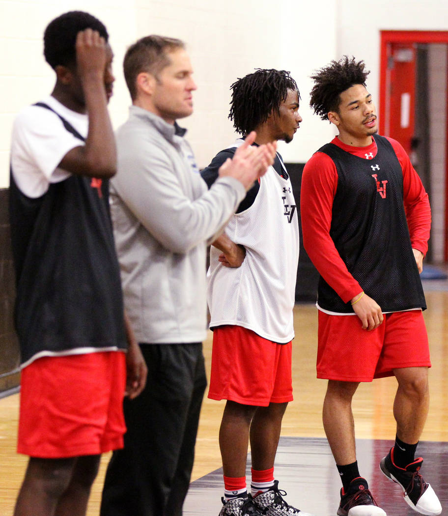 Las Vegas High School point guard Donovan Joyner, right, talks to teammate Ronnie Moore, second from right, during practice Monday, Jan. 8, 2018. The 5-foot-9 Joyner is one of the top players in t ...