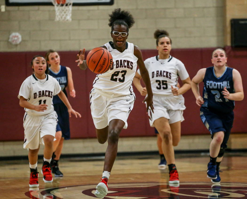 Desert Oasis' Desi-rae Young (23) dribbles the ball up court during the second quarter of a basketball game against Foothill at Desert Oasis High School in Las Vegas, Monday, Dec. 4, 2017. Desert  ...