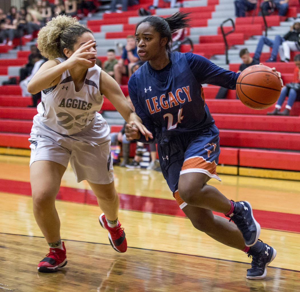Legacy's Maiah Yearwood tries to dribble around Arbor View's Amiya Lattomus at Arbor View High School on Thursday, Jan. 11, 2018. Legacy won 53-39. Patrick Connolly Las Vegas Review-Journal @PConnPie