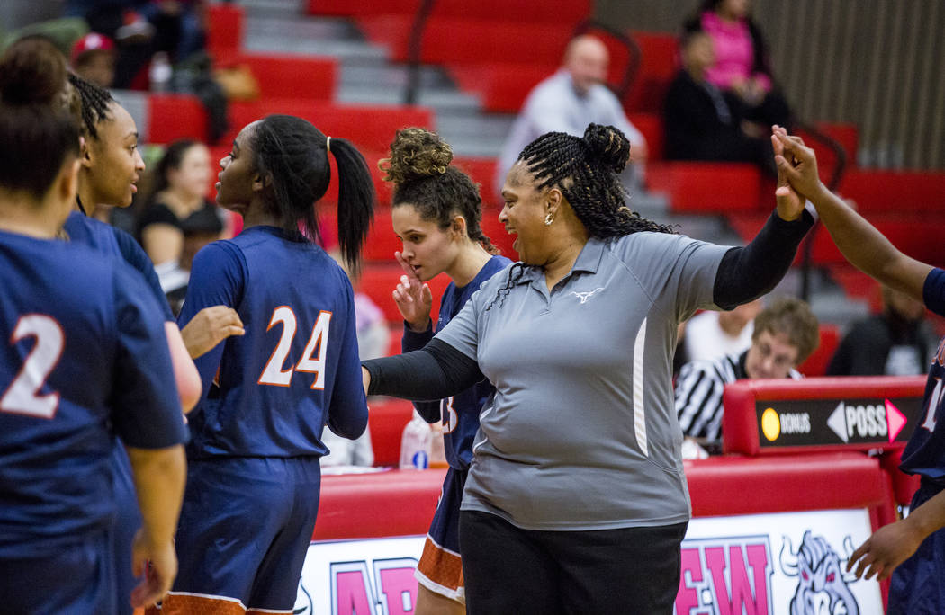 Legacy coach Tiffany Richardson celebrates with her players after winning against Arbor View at Arbor View High School on Thursday, Jan. 11, 2018. Legacy won 53-39. Patrick Connolly Las Vegas Revi ...