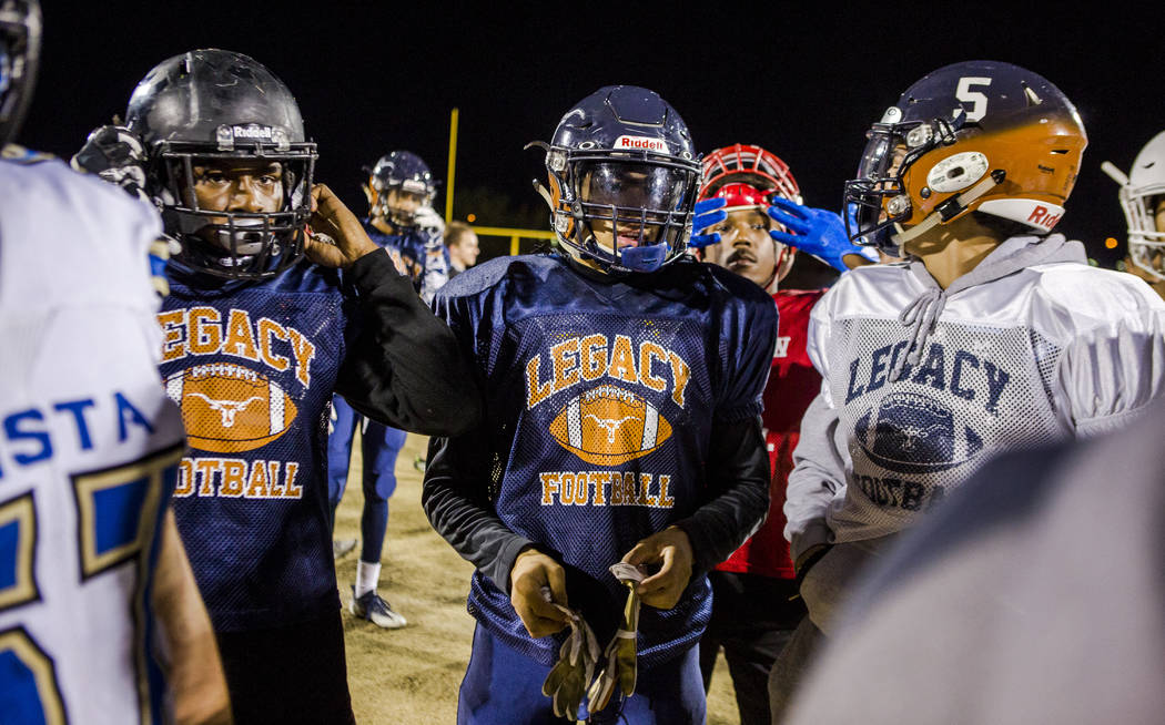 Legacy running back Aubrey Washington, center, in a huddle during practice for the all-star game at Legacy High School on Wednesday, Jan. 10, 2018. Patrick Connolly Las Vegas Review-Journal @PConnPie