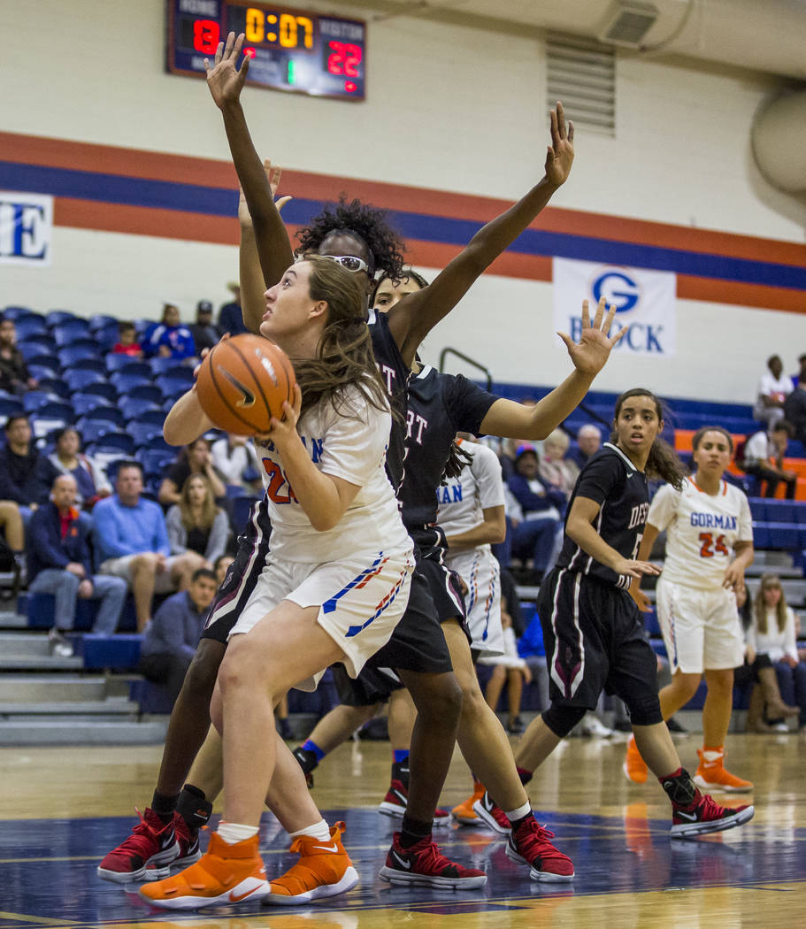 Bishop Gorman's Tierney Holcombe looks for a shot against Desert Oasis defenders at Bishop Gorman High School on Friday, Jan. 12, 2018. Desert Oasis won 69-61. Patrick Connolly Las Vegas Review-Jo ...