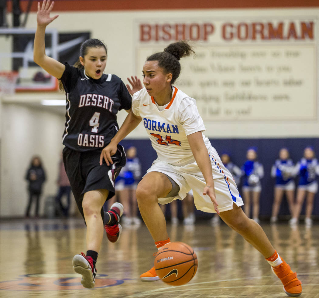 Bishop Gorman's Bentleigh Hoskins dribbles past Desert Oasis' Brianna Clark at Bishop Gorman High School on Friday, Jan. 12, 2018. Desert Oasis won 69-61. Patrick Connolly Las Vegas Review-Journal ...