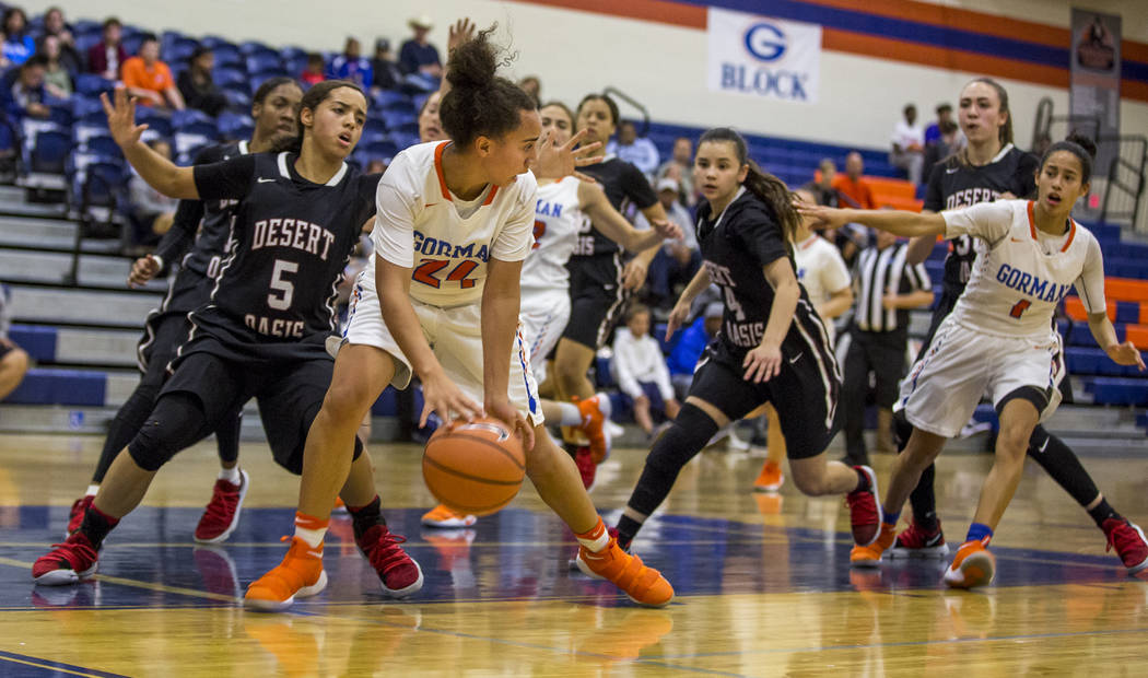 Bishop Gorman's Bentleigh Hoskins attempts to control the ball against Desert Oasis defenders at Bishop Gorman High School on Friday, Jan. 12, 2018. Desert Oasis won 69-61. Patrick Connolly Las Ve ...