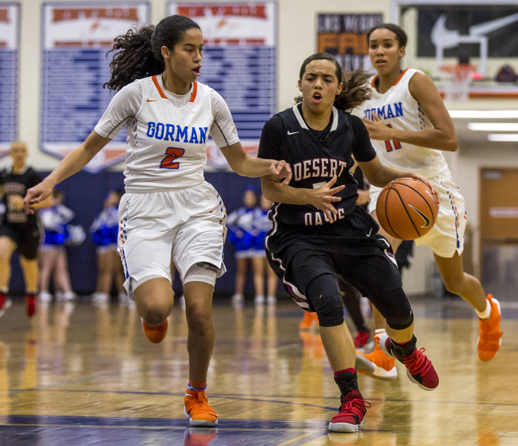 Desert Oasis' Eliyjah Pricebrooks attempts to dribble around Bishop Gorman's Shaira Young at Bishop Gorman High School on Friday, Jan. 12, 2018. Desert Oasis won 69-61. Patrick Connolly Las Vegas  ...
