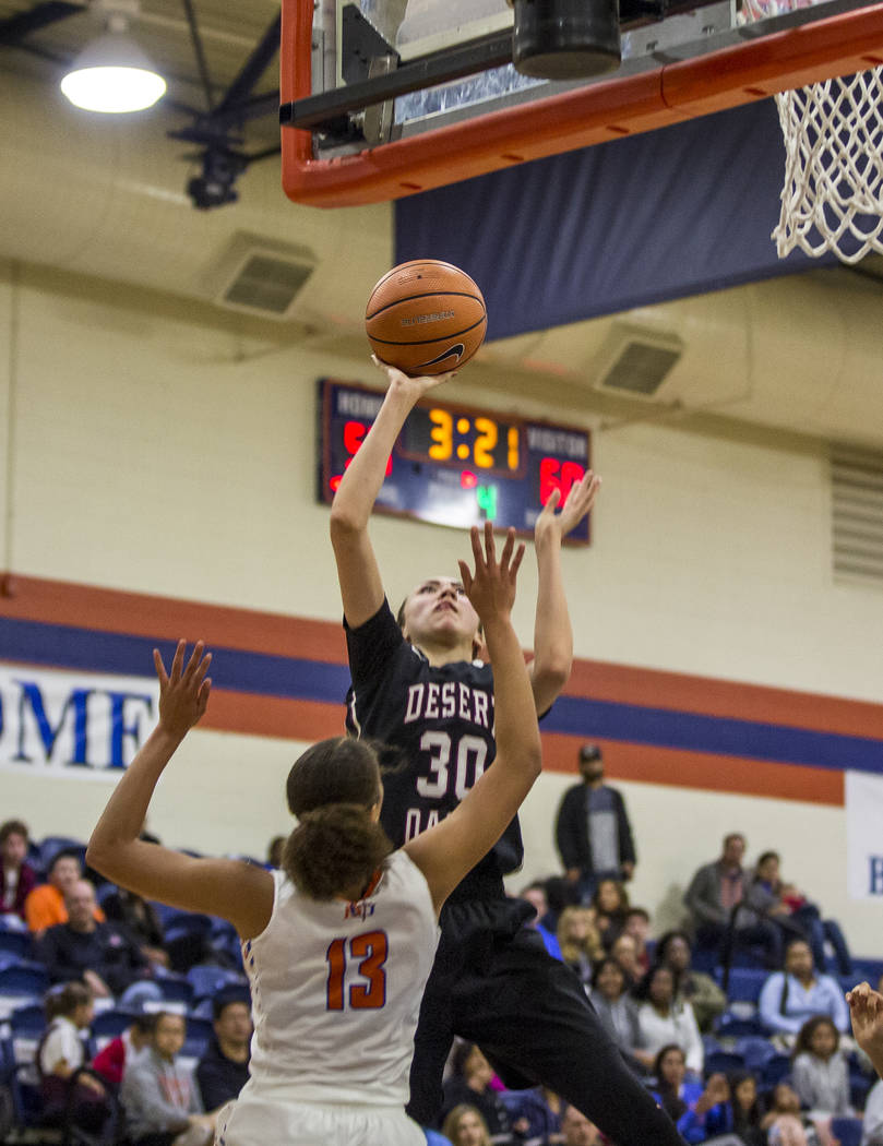 Desert Oasis' Sierra Mich'l attempts to put points up while Bishop Gorman's Georgia Ohiaeri tries to block her at Bishop Gorman High School on Friday, Jan. 12, 2018. Desert Oasis won 69-61. Patric ...