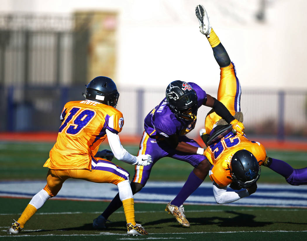 Sunset cornerback Chinonso Ugochukwu tackles a Sunrise player during the Lions All-Star football game at Bishop Gorman High School in Las Vegas, Jan. 13, 2018. Sunset beat Sunrise 21-6. Andrea Cor ...