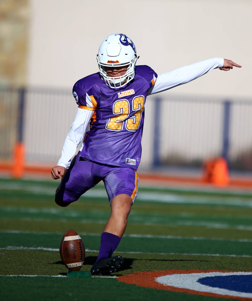 Sunset kicker Derek Ng, of Bishop Gorman High School, prepares to kick the ball during the Lions All-Star football game at Bishop Gorman High School in Las Vegas, Jan. 13, 2018. Sunset beat Sunris ...
