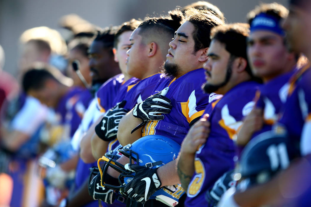 Sunset football players stand for the national anthem before the Lions All-Star football game at Bishop Gorman High School in Las Vegas, Jan. 13, 2018. Sunset beat Sunrise 21-6. Andrea Cornejo Las ...