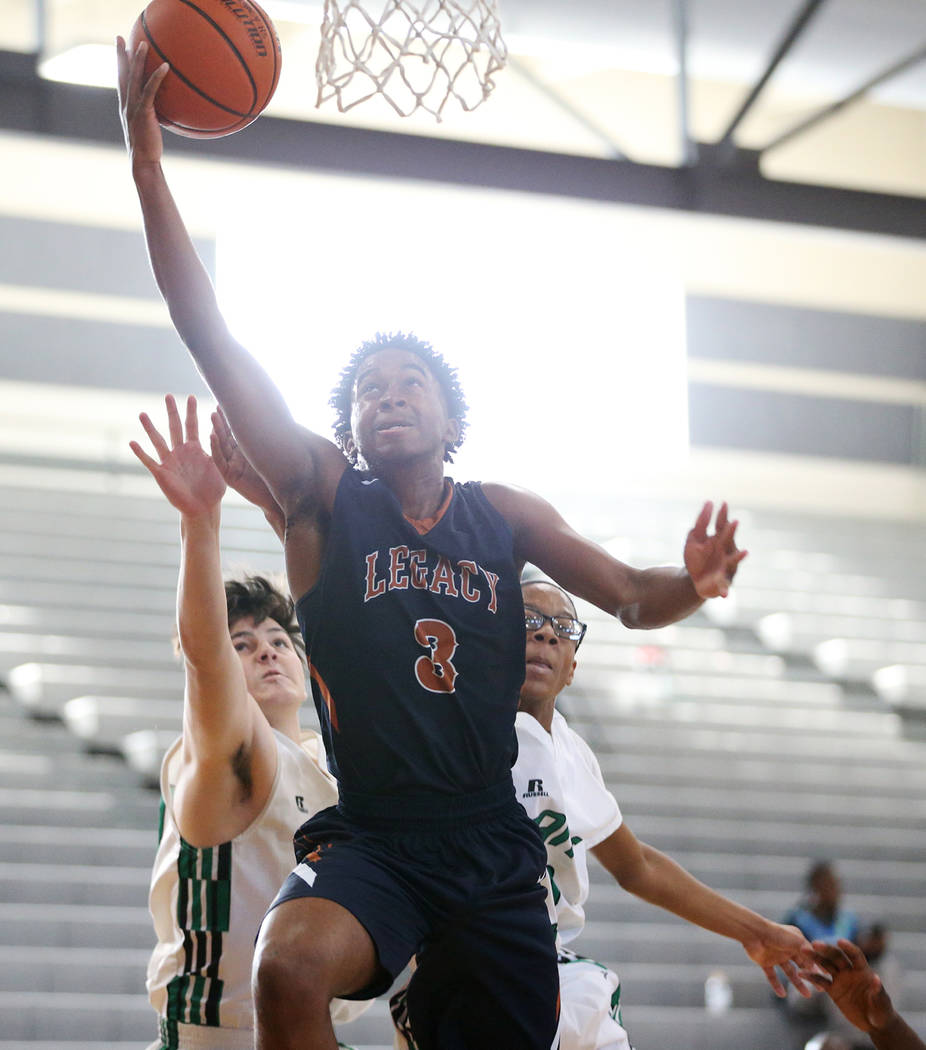 Legacy's Christian Pitts (3) goes up for a shot against Rancho in the boy's basketball game at Durango High School in Las Vegas, Saturday, Jan. 13, 2018. Erik Verduzco Las Vegas Review-Journal @Er ...