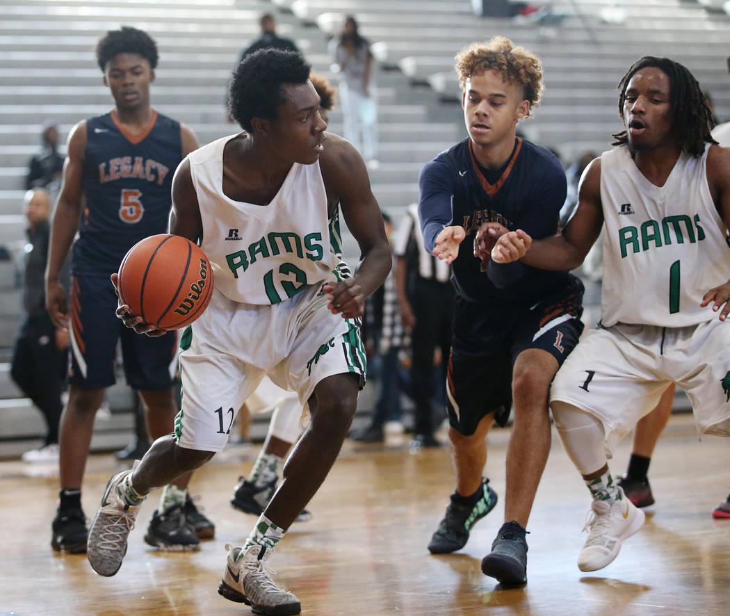 Rancho's Nick Merkson (12) looks for an open pass against Legacy in the boy's basketball game at Durango High School in Las Vegas, Saturday, Jan. 13, 2018. Erik Verduzco Las Vegas Review-Journal @ ...