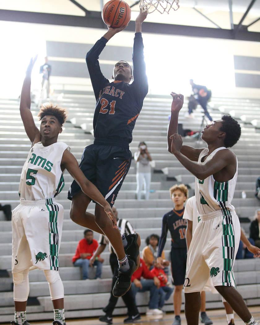 Legacy's Jordan Cineus (21) goes up for a lay up against Rancho in the boy's basketball game at Durango High School in Las Vegas, Saturday, Jan. 13, 2018. Erik Verduzco Las Vegas Review-Journal @E ...
