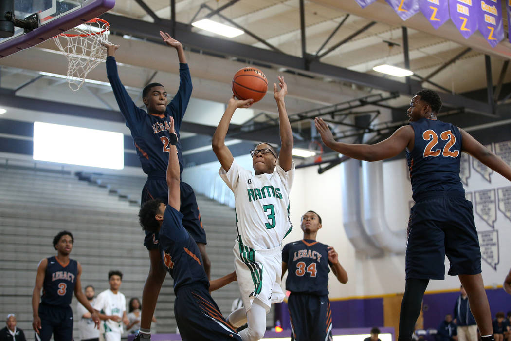 Rancho's Peter Smith (3) goes up for a shot against Legacy in the boy's basketball game at Durango High School in Las Vegas, Saturday, Jan. 13, 2018. Erik Verduzco Las Vegas Review-Journal @Erik_V ...